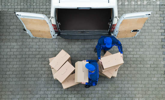 Aerial view of unloading boxes from a truck