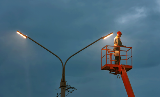 Technician on aerial device