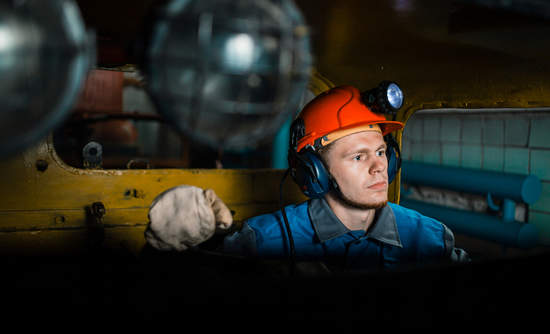 Young miner working underground