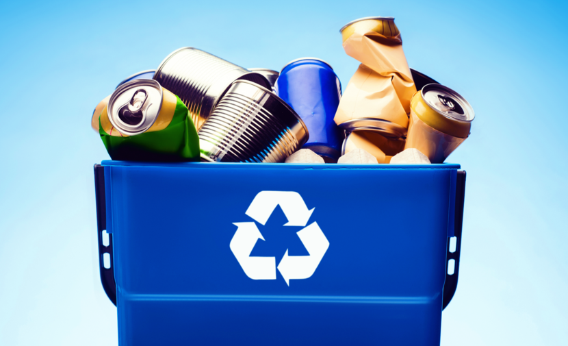 bottles and cans in a recycling bin