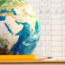 Globe on table next to report card
