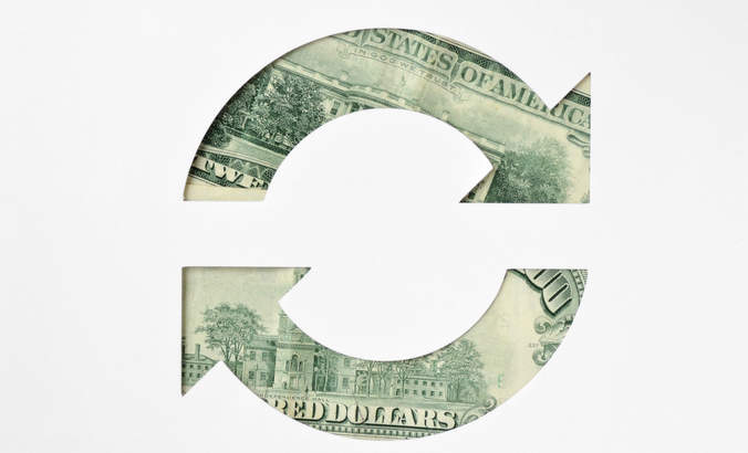 Circular arrows made of dollar banknotes