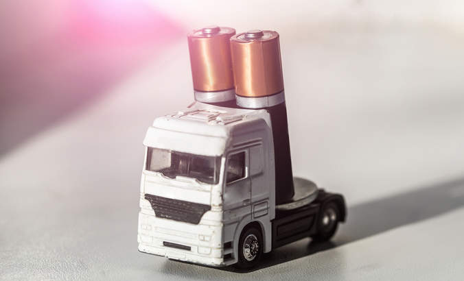 Toy truck carrying two AA batteries as its power supply