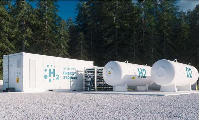 3d rendering of renewable energy storage - hydrogen gas to clean electricity facility situated in forest environment.