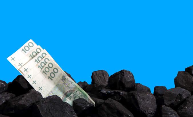 Paper money lies on black coal