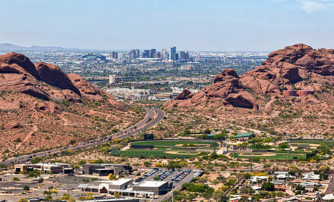 Aerial view of Downtown Phoenix, Arizona from Scottsdale, framed between the Papago Buttes.