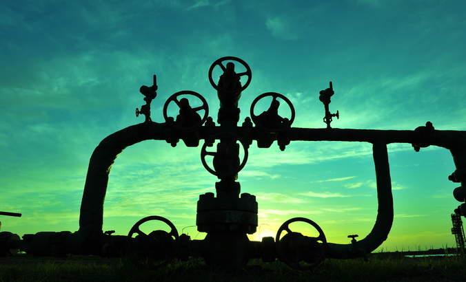 Natural gas pipes at sunset