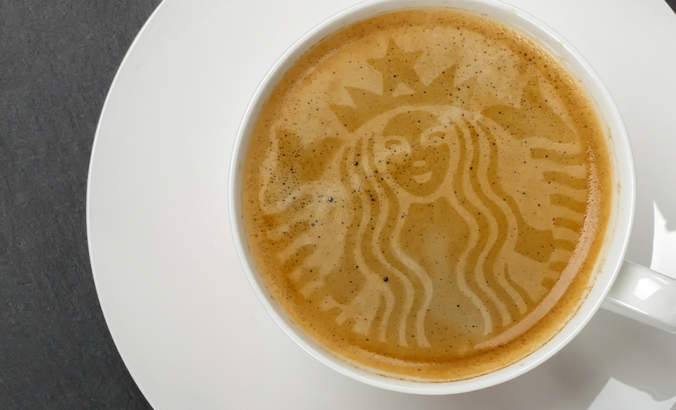 A latte with the Starbucks logo in the foam