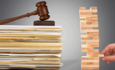 stack of papers with gavel and jenga blocks