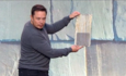 Tesla debuts sleek glass solar rooftop tiles featured image