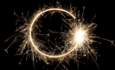 sparkler drawing a circle on night sky