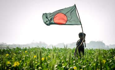 Boy with Bangladeshi flag