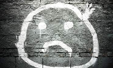 Sad face graffiti.