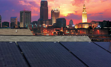 Rooftop solar panels soak up the last rays of a Cleveland sunset