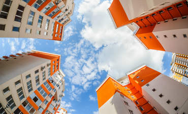 Fisheye view to the sky of an apartment building
