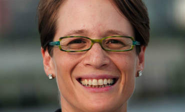 Author Christine Bader explains corporate idealism featured image