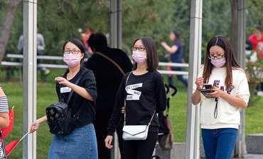 Women in masks in Beijing.