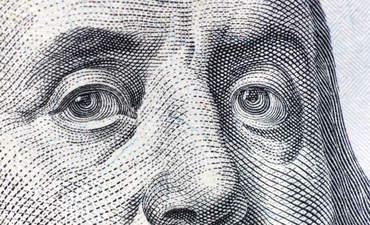 Close-up of Benjamin Franklin on currency