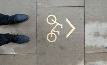 Bike path marking on the ground.