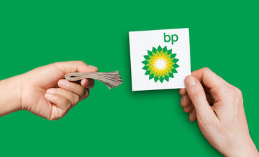 BP sign and money hands