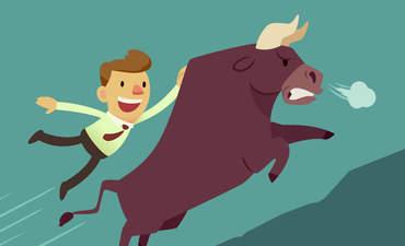 Cartoon of a business man riding a bull