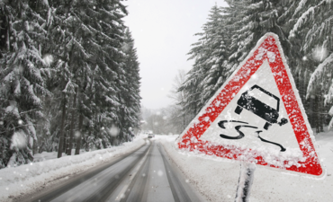 car sign on snowy road