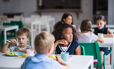 Small school children eating lunch