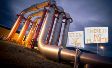 oil pipeline and climate change activist signs