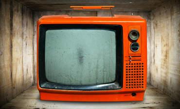 A bright orange CRT television