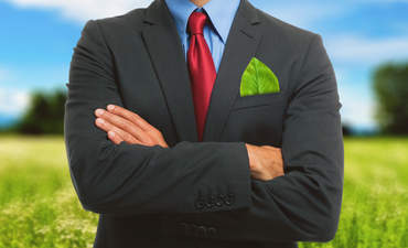 businessperson with leaf in pocket