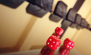 Red pair of dice at boardroom table