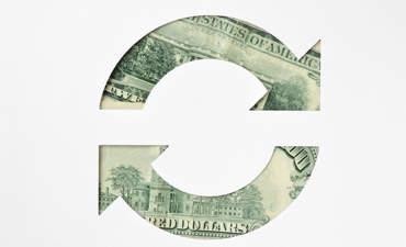Circular arrows made of dollar banknotes