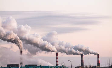 Industrial chimneys spewing emissions