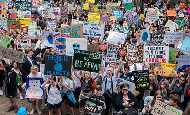 Thousands of Australian students gather for protest rally, School Strike 4 Climate, to demand urgent action on climate change.