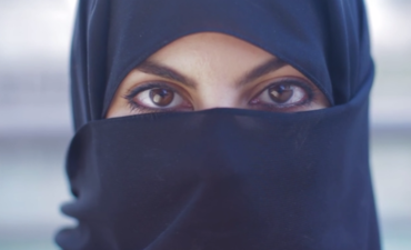 Image of a woman's eyes peering from a niqab
