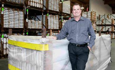 Finelite COO Mark Benguerel with reusable shipping crates