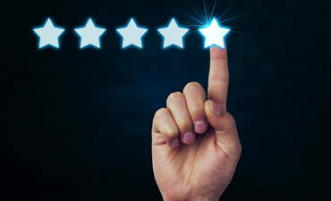 Finger pointing to 5 stars