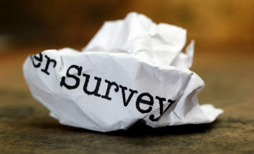 Crumpled-up, discarded customer survey