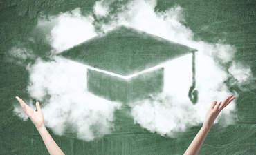 A graduate cap drawn on a chalkboard