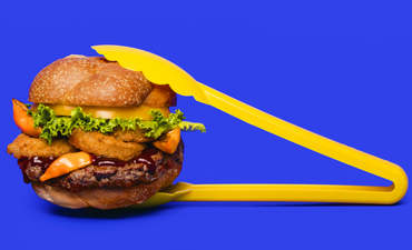 The Impossible Burger with tongs