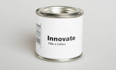 "Can of paint labeled with the word ""innovation"""