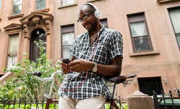 Man with a mobile phone wearing earbuds