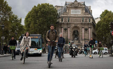 Busy mix of roadway traffic around place Saint Michel in Central Paris