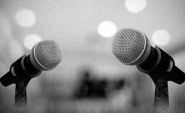 Photo of microphones set up for debate