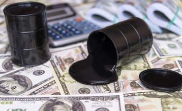 oil barrels on top of cash