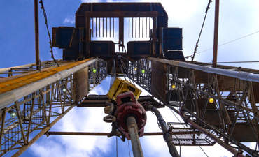 An oil drilling rig viewed from below.