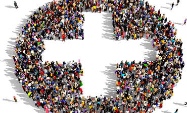 People forming a plus sign, seen from above