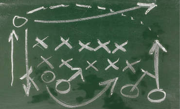 Illustration of a football field play on a chalkboard