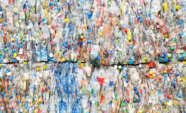 Plastic bottles compressed and prepared to be recycled