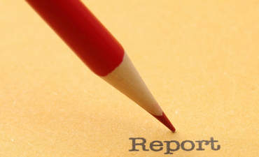 Report with red pencil